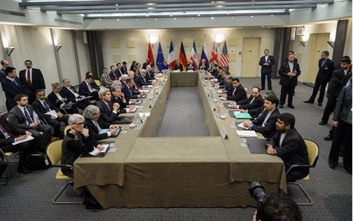 Officials of Britain, Russia, China, France, Germany, European Union, the United States and Iran wait for the start of a meeting on Iran's nuclear program at the Beau Rivage Palace Hotel in Lausanne, Switzerland Monday, March 30, 2015. Negotiations are entering a critical phase with differences still remaining just two days before a deadline for the outline of an agreement. (AP Photo/Brendan Smialowski, Pool)